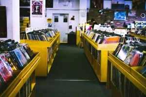 a picture of an organized vinyl record collection in a store